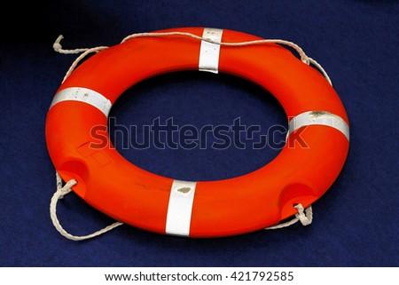Florescent orange lifebuoy life ring - stock photo