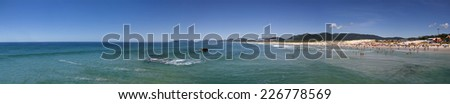 Florianopolis, Santa Catarina, Brazil - January 18, 2010: Panoramic view in Brazil of a Brazilian horizon on water and a beach called Joaquina located in Florianopolis city in Santa Catarina state. - stock photo