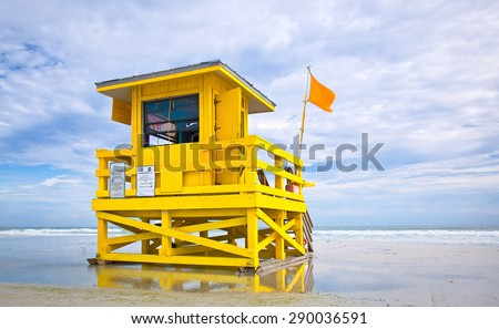 Florida beach yellow lifeguard house on a cloudy summer day  , Siesta Key  - stock photo