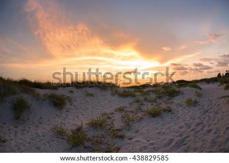 Florida coast sunset on the beach of Venice Florida in the summer - stock photo