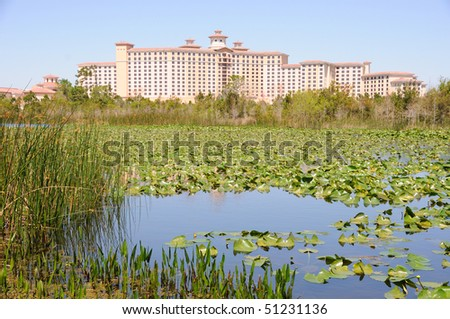 Florida Hotel near Marshland and Pond - stock photo