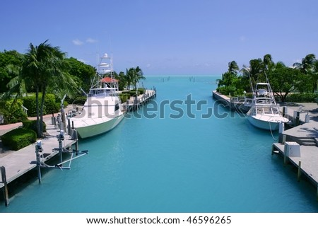 Florida Keys fishing boats in turquoise tropical blue waterway - stock photo