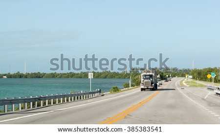 FLORIDA KEYS, USA - DEC 13, 2015: Traffic on Overseas Highway US 1 on Long Key, Florida Keys, USA