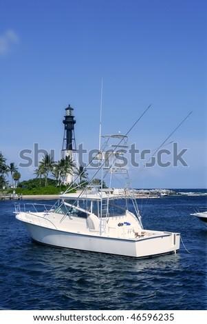 Florida Lighthouse Pompano Beach with summer boats - stock photo