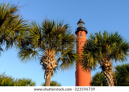Florida Palm trees frame the gorgeous Ponce De Leon Lighthouse - stock photo