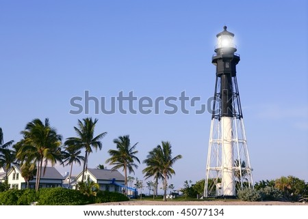 Florida Pompano Beach Lighthouse palm trees and blue sky - stock photo