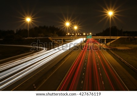Florida Turnpike South at Pompano Beach Tail Lights Night - stock photo