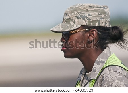 "FLORIDA, USA - NOVEMBER 6: Air Force female soldier guards performance of ""Wings Over Homestead"" Event on November 6 2010 at Homestead, Fl. USA. This event takes place at the Homestead Air Force Base"