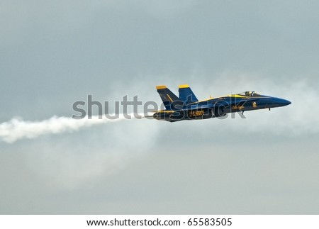 "FLORIDA, USA - NOVEMBER 6: Blue Angel across the sky during performance on ""Wings Over Homestead Show"" on November 6 2010 at Homestead, Fl. USA. This event takes place at the Homestead Air Force Base - stock photo"