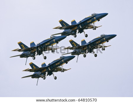"FLORIDA,  USA - NOVEMBER 6: Blue Angels taking off during performance on ""Wings Over Homestead Show"" on November 6 2010 at Homestead, Fl. USA. This event takes place at the Homestead Air Force Base - stock photo"