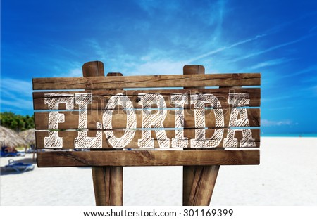 Florida wooden sign on the beach - stock photo
