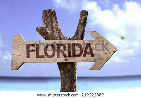 Florida wooden sign with a beach on background - stock photo
