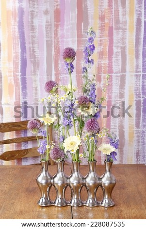 Florist at work: How to make floral arrangement in silver vase - step by step, tutorial - stock photo