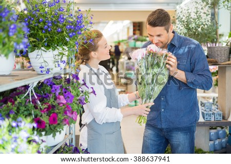 Florist Giving Customer To Smell Fresh Flower Bouquet - stock photo