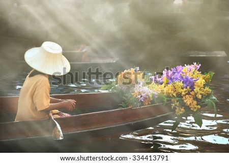 Florist on boat - stock photo