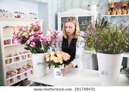 Florist preparing for the day at work - stock photo