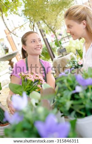 Florist serving customer - stock photo