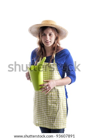 florist with summer hat and watering can. isolated on white background - stock photo