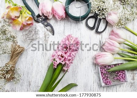Florist workplace: flowers and accessories  - stock photo
