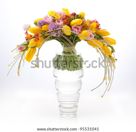 Floristics - Colorful Vernal Flowers Bouquet Arrangement in Vase - Greeting Card - stock photo