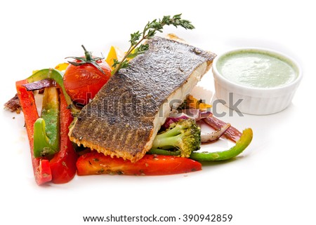 Flounder with vegetables and green sauce - stock photo