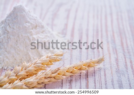 flour and ears of wheat on white vintage desk with copyspace for your text food and drink concept  - stock photo