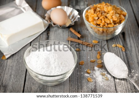 flour and raisins for baking - stock photo