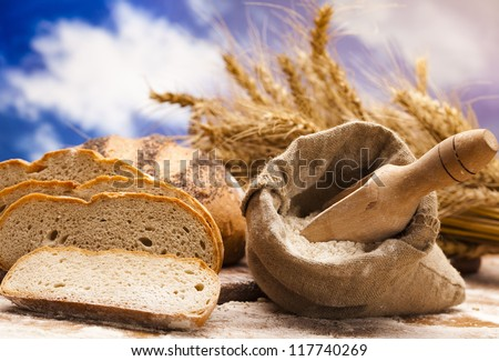 Flour and traditional bread - stock photo