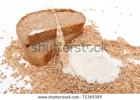 Flour and wheat grain with bread - stock photo