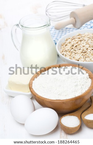 flour, butter, cereal and ingredients for baking, vertical