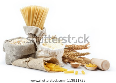 Flour, cereals, pasta in a canvas bag and ear on white background. - stock photo