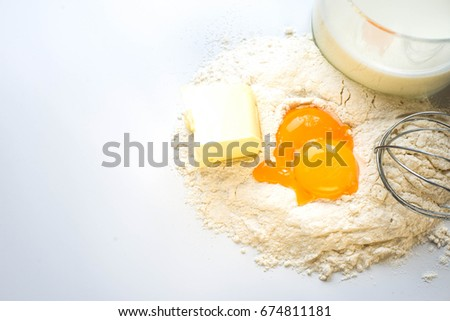Flour eggs and milk on a white background