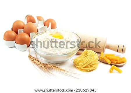Flour, eggs, pasta, baking ingredients for cooking isolated on white background. - stock photo