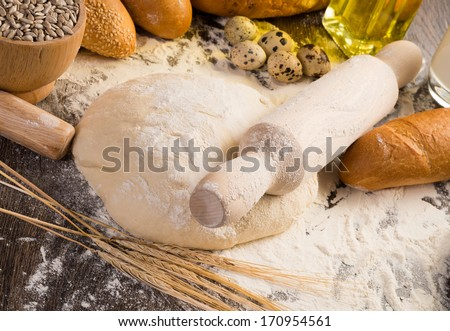 flour, eggs, white bread, wheat ears. still life - stock photo