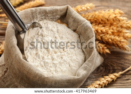 flour in a bag on a table on the old boards.