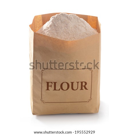 Flour in brown craft paper bag on white background - stock photo