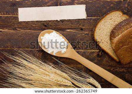 Flour in spoon bread next to the grains. - stock photo