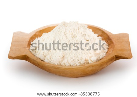 Flour in wooden homemade bowl