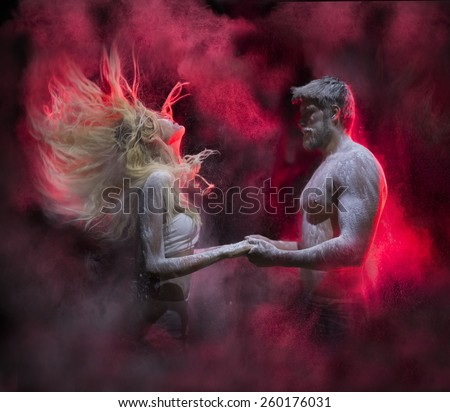 flour man and woman.photos of men and women who hold hands and their surrounds mystical smoke - stock photo