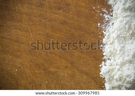 flour on dirty worn desk and space for your text. background