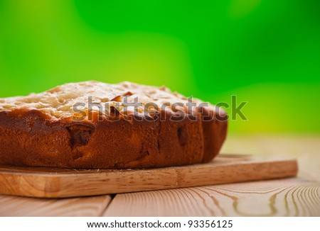 flour products, fresh pie on wooden kitchen table with green background