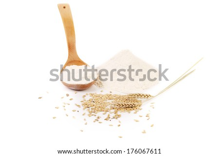 Flour wheat ear and wood spoon. Isolated on a white background. - stock photo