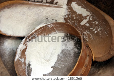 flour with sifter and big spoon in rural