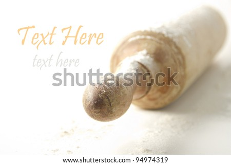 floured rolling pin on a white background - stock photo