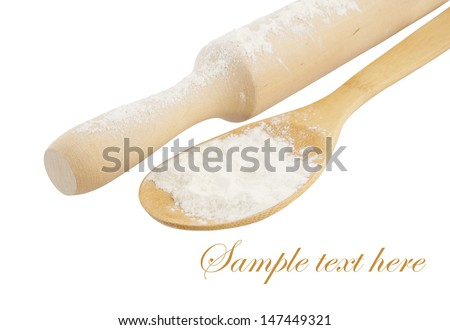 Floured rolling pin with spoon isolated on white background  - stock photo