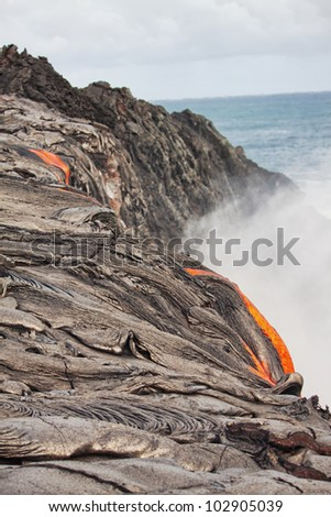 flow of red hot lava closeup - stock photo