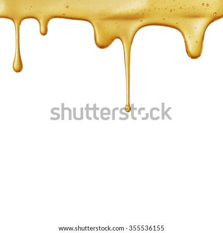 flow of sweet honey on the white background. Isolated. - stock photo