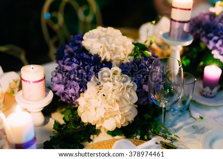 Flower arrangement at a wedding banquet - stock photo