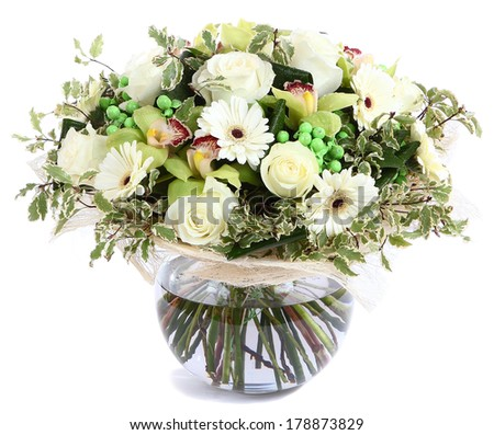 Flower arrangement in glass, transparent vase: White roses, orchids, white gerbera daisies, green peas. Isolated on white background. Floristic composition, design a bouquet, floral arrangement.  - stock photo