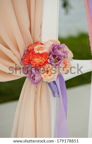 Flower Arrangement on Wedding Ceremony. Tea roses and violet tulips - stock photo